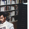 Library patron David Tate reading the newspaper in the Business Science Department, 1984.