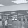 The library's card catalog is shown, near the new ROM catalog that will soon replace the card catalog, 1976.