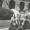 Soldiers on a vehicle in front of the Forsyth County Courthouse, 1941.