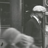 Man pushing a carriage in the 300 block of North Main Street, 1928.