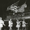 Majorettes in a Christmas parade marching in front of the Carolina Theatre on West Fourth Street, 1956.