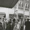 People walking on sidewalks on West Fourth Street near Liberty Street, 1951.