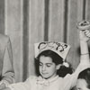 Celebrating the Jewish holiday, Purim, 1952.