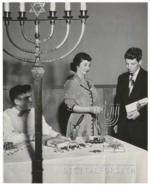 Celebrating the Jewish holiday Hanukkah, the Festival of Lights, 1953.