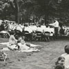 Moravian band conductor, Austin Burke, directing the band for an outdoor concert, 1970.
