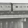 Southern Railway passenger train approaches a bridge on its way into Winston-Salem, 1970.