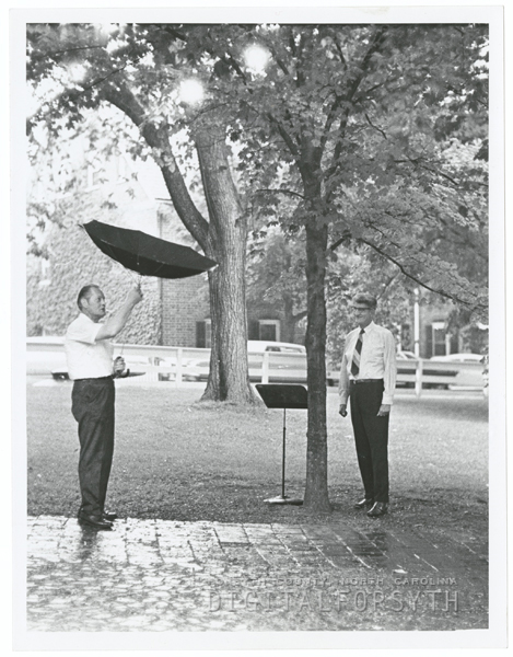 Joe Watkins and Austin Burke watch the rain which caused the cancellation of the Salem band concert, 1971.