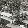 Aerial photo showing the 600 block of Main Street, the P. H. Hanes Knitting Company (at center), and the surrounding area.