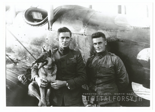 Belvin Wooten Maynard, at center, with his dog 'Trixie,' and his mechanic William Kline.