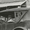 Rural mail carrier, T. E. Woosley, with his 1919 touring car which he uses to deliver the mail, 1939.