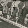 Taylor's Tobacco Warehouse, with men marking with paint the individual spaces for tobacco sellers, 1939.