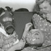 Louise Evans and Doris Sherrill with gas masks, 1939.