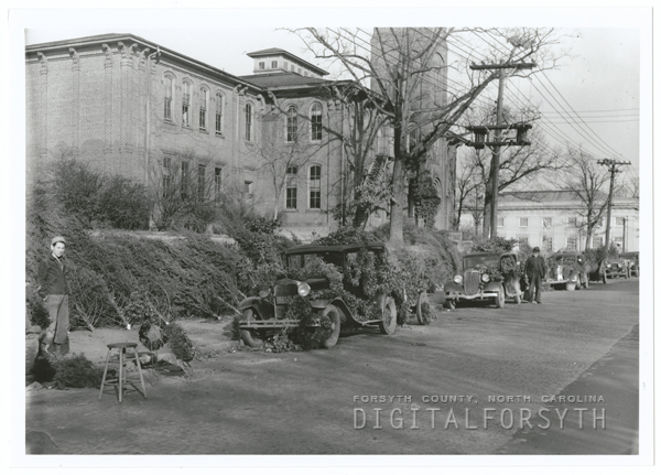 Selling Christmas trees on W. Fourth Street near the West End School, 1939.