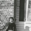 Mrs. Poe showing crack in chimney of old Alec Conrad House, 1967.