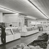 Interior photo of the City Market, showing the meat and vegetable markets, 1967.