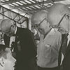 Joe White and Jim Dalrymple, at left, examine heads for the baldest man contest, 1967.