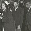 Funeral for James Eller. His mother, Hattie Eller Frost, is helped by nurses, 1967.