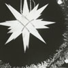 View of the Reynolds Building and a Moravian star in a wreath at Christmas, 1967.
