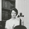 Barby Rickert playing the cello, 1965.