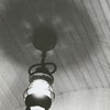 Don Hamrick puts light bulb back into the fixture after it stopped burning, but later worked, 1964.