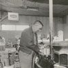 Harvey Bodenhamer and wife in their grocery store, 1964.
