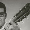 John Arant, playing the guitar, 1964.