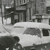 Stuck in the snow at the intersection of Cherry and Sixth Street, 1962.