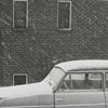 Car parked beside the apartments on Brookstown Avenue at Spring Street, 1962.