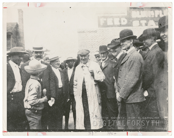Thomas Edison (white coat) surrounded by Winston residents.