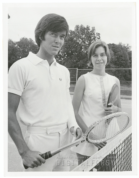 Dick Parris and Elizabeth Sawyer, assisting with the city's tennis program for the summer, 1973.