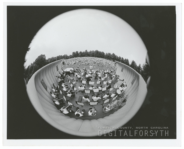 Fisheye lens view of the spectators and symphony at the Music at Sunset concert at Graylyn Estate, 1973.
