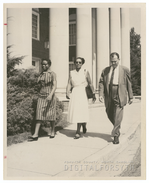 Gwendolyn Bailey entering R. J. Reynolds High School, 1957.