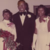 Dr. Kenneth Raynor Williams with Miss Alumni 1974 Verndene Pettiford and her Court